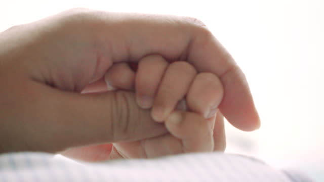parent holding newborns hand - newborn stock videos & royalty-free footage