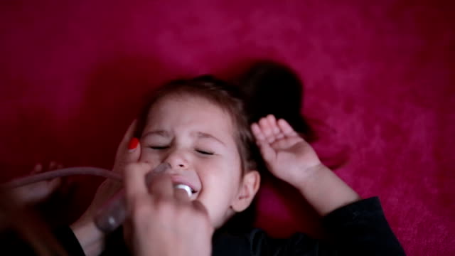 parent is vacuuming saliva and mucus from nose - mucus stock videos & royalty-free footage