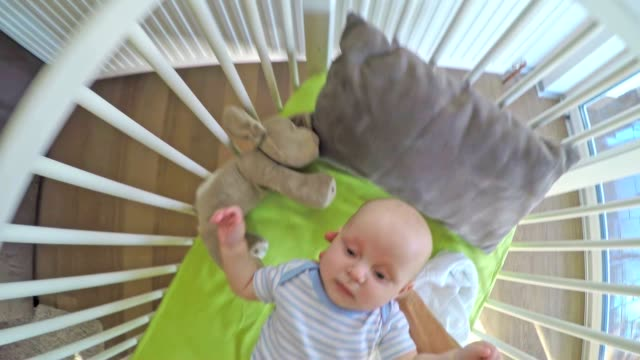 POV Parent putting his baby into the crib