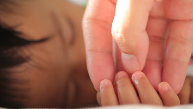 hd : parent touching baby hands - genderblend stock videos & royalty-free footage