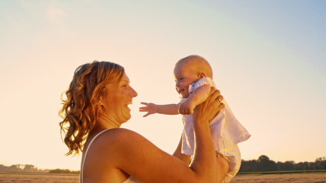 slo mo parental warmth and affection - sundress stock videos & royalty-free footage