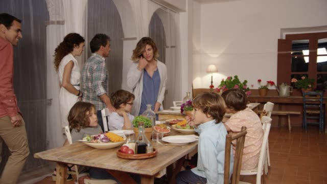 parents and children having dinner at dining table - dinner party stock videos & royalty-free footage