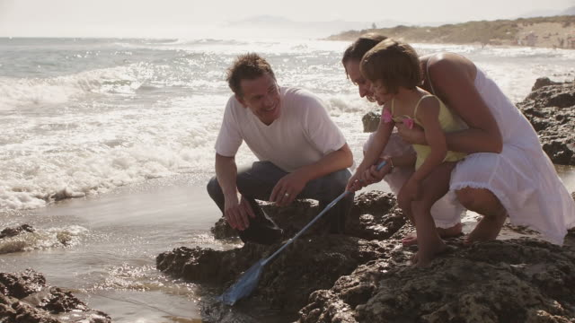 Parents and daughter playing at the beach/Marbella region, Spain