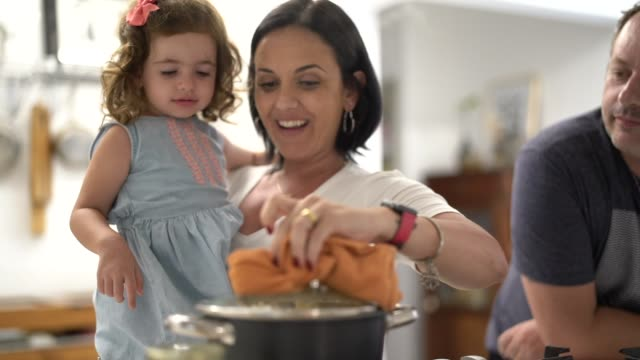 parents and daughter preparing popcorn at home - one parent stock videos & royalty-free footage