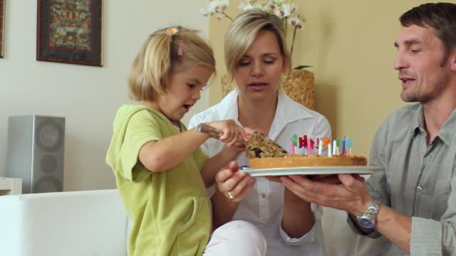 MS Parents And Daughter 4 5 Slicing Birthday Cake Potsdam Brandenburg