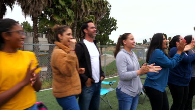 ts parents and families on sideline of field cheering for soccer players - cheering stock videos & royalty-free footage