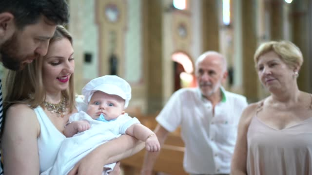 parents and his son on baptism celebration at church - young family stock videos & royalty-free footage