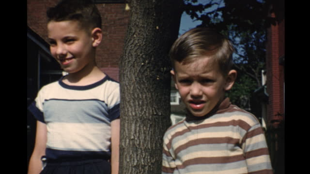 1952 home movie parents and kids playing in backyard / toronto, canada - brother stock videos & royalty-free footage