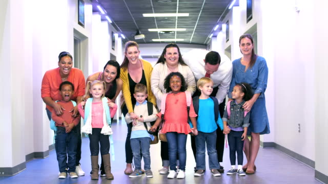 parents and preschool children in hallway of school - 25 29 years stock videos and b-roll footage