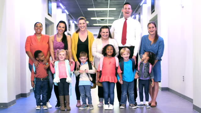 parents and preschool children in hallway of school - nursery school child stock videos & royalty-free footage