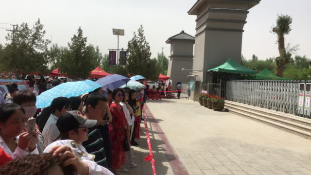 Parents are waiting outside the Dunhuang high school where their children are taking their college entrance examination On June 78 the college...