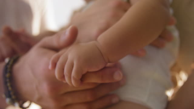 parents cuddling girl - 6 11 months stock videos and b-roll footage