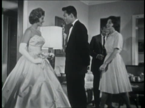 b/w 1961 parents + date greeting teenage girl in prom dress in living room / she + date leave / educ - prelinger archive stock-videos und b-roll-filmmaterial