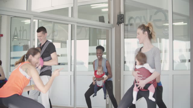 4K: Parents Exercising With Their Babies In A Gym