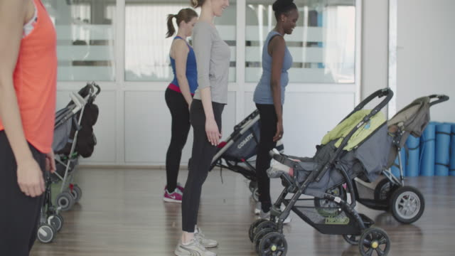 4k: parents exercising with their babies in strollers. - pushchair stock videos and b-roll footage