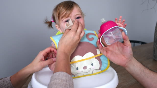 parents feeding daughter - 6 11 months stock videos & royalty-free footage