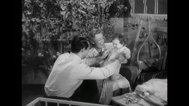 1941 Parents ( Cary Grant & Irene Dunne) happily play with their baby