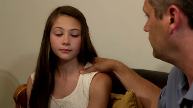 Parents have Serious Discussion with Daughter - Close Up