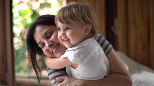 parents having fun with a cute daughter - affectionate stock videos & royalty-free footage