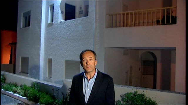 parents of madeleine mccann give interview on anniversary of her disappearance; praia da luz: night reporter to camera - disappearance of madeleine mccann stock videos & royalty-free footage