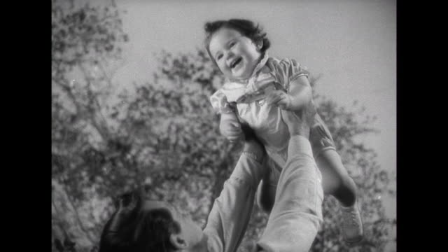 1941 Parents (Cary Grant & Irene Dunne) playing with baby when visitor knocks