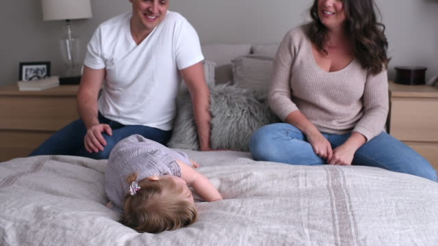 parents playing with daughter - 6 11 months stock videos & royalty-free footage