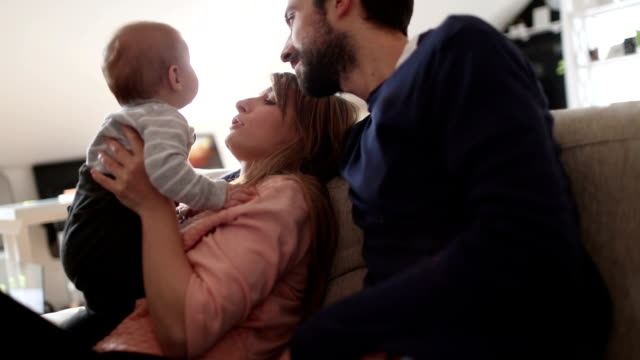 Parents playing with their baby