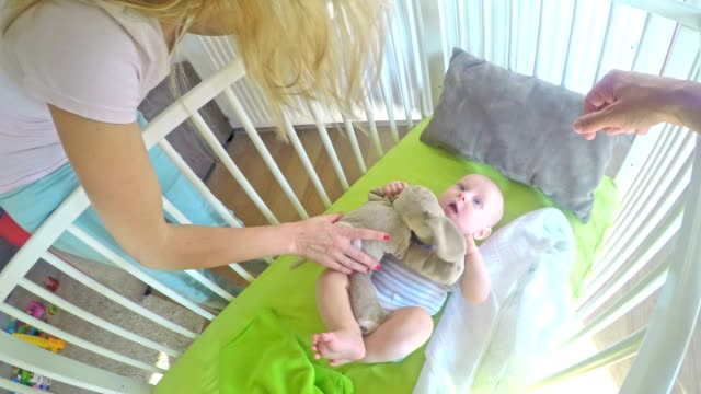 pov parents preparing their baby for a nap - blanket stock videos & royalty-free footage