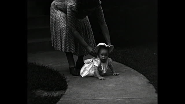1940 - parents teaching baby how to walk - 1940 stock videos and b-roll footage