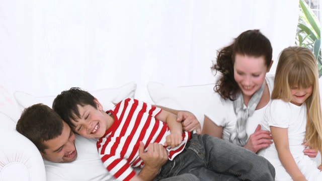ms parents tickling son and daughter (5-8) on sofa / cape town, south africa - tickling stock videos & royalty-free footage