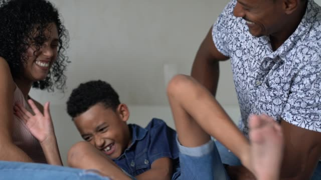 parents tickling son at home - tickling stock videos & royalty-free footage