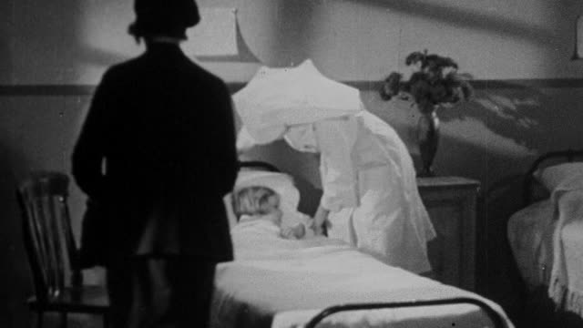 1930 montage parents visiting child in hospital and speaking with the nurse / united kingdom - 1930 stock-videos und b-roll-filmmaterial