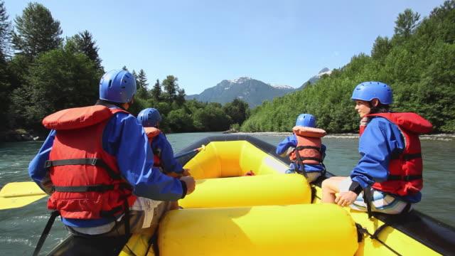 MS POV Parents with children (8-11) rafting through rapids in Squamish River forest / Squamish, British Columbia, Canada