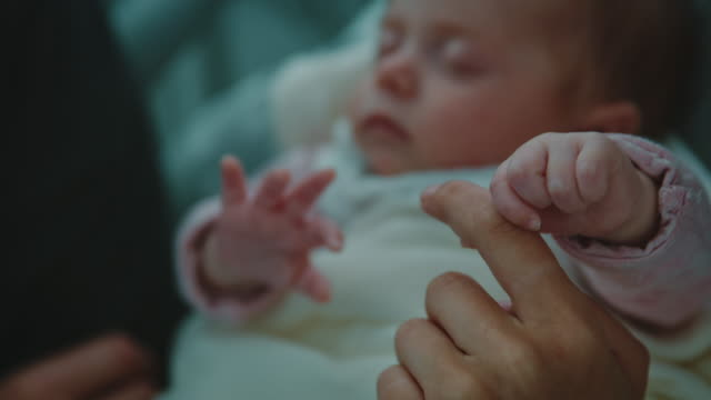 parents with cute sleeping newborn in hospital - trust stock videos & royalty-free footage