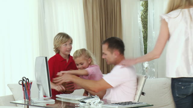 ms parents with daughter and son (8-9) at home, kids trying to type on dad's computer / cape town, south africa - see other clips from this shoot 1811 stock videos & royalty-free footage