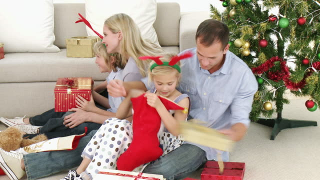 ms parents with daughter (8-9) and son (4-5) opening christmas presents / cape town, south africa - see other clips from this shoot 1811 stock videos & royalty-free footage