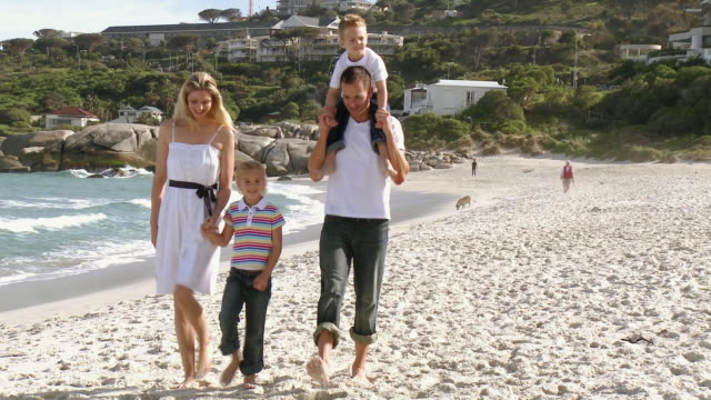 WS Parents with daughter (8-9) and son (4-5) walking on beach / Cape Town, South Africa