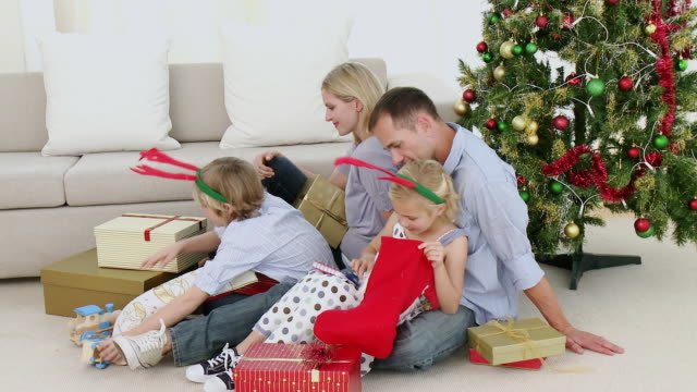 ws parents with son and daughter (8-9) opening christmas presents / cape town, south africa - see other clips from this shoot 1811 stock videos & royalty-free footage