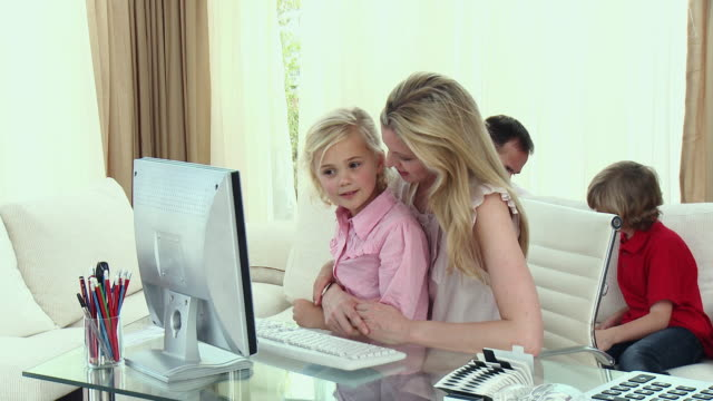 ms parents with son and daughter (8-9) relaxing in home office / cape town, south africa - see other clips from this shoot 1811 stock videos & royalty-free footage