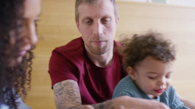 parents with toddler at breakfast table - multiracial person stock videos & royalty-free footage