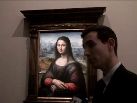 andrea olea the prado museum's 'la gioconda' painted in leonardo da vinci's workshop by a disciple went on display at the louvre on tuesday near the... - 復元する点の映像素材/bロール