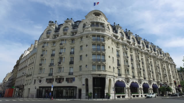 paris, april 21, 2020. palace le lutetia closed following the coronavirus crisis. street in front of the hotel facade, with only four pedestrians, a... - five people stock videos & royalty-free footage
