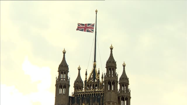 Westminster flags fly at half mast ENGLAND London Westminster EXT Union Jack flag flying at half mast over government building in Westminster/ Union...