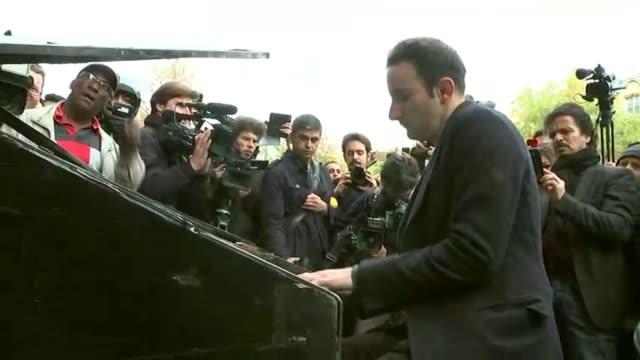 129 people killed across the city france paris ext shots of piano player in paris playing john lennon's 'imagine' sot - john lennon video stock e b–roll