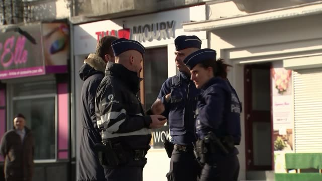 Abdelhamid Abaaoud's roots in Molenbeek BELGIUM Brussels Molenbeek Various shots mosque with wall sculpture Police officers talking together on...