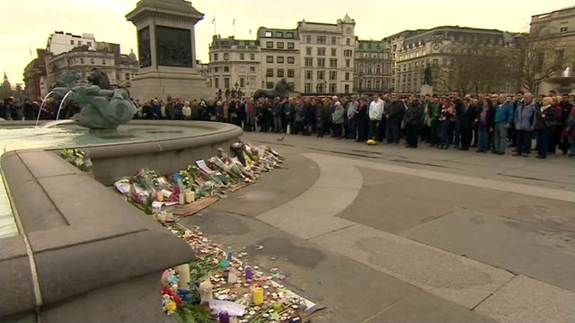 Francois Hollande announces measures to tackle IS terrorism ENGLAND London Trafalgar Square People observing minute's silence