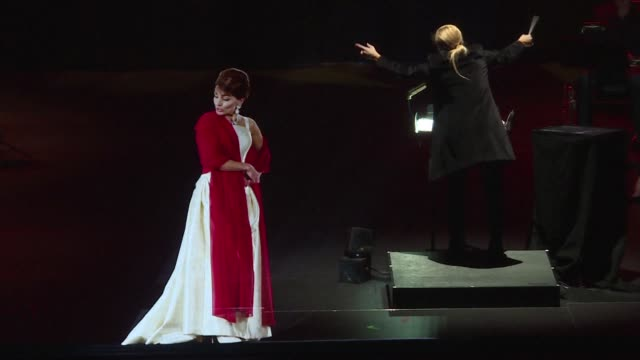 paris audience members respond with astonishment delight and in some cases disappointment at seeing a hologram of maria callas perform some of her... - holographic stock videos & royalty-free footage