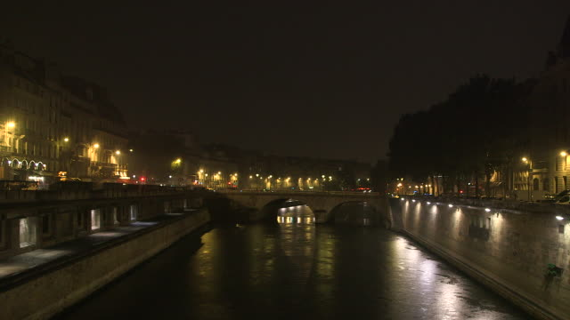 paris by night, the seine with lighting reflections, thunderstorm - river seine stock videos & royalty-free footage