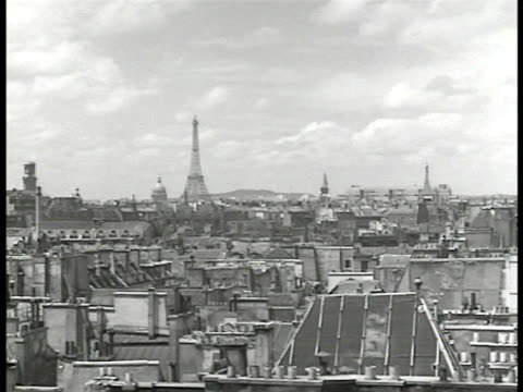paris city buildings houses eiffel tower bg ws notre dame cathedral seine river fg ws group of french men on street w/ newspaper ws two french... - 1946 stock videos and b-roll footage