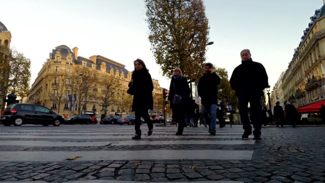 Paris City Traffic and Pedestrians on the Champs Elysees at Sunset